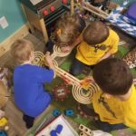 Kindergarten playing with marbles